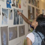Christina and her classmates admire UM student art in Peterson Hall